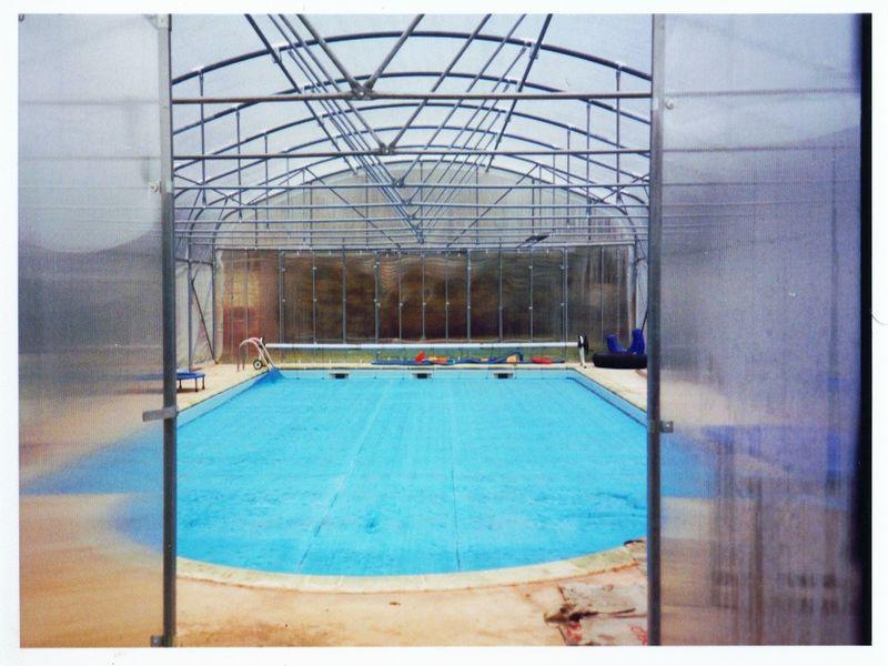Abris de piscine Calmel Pretamo tout temps